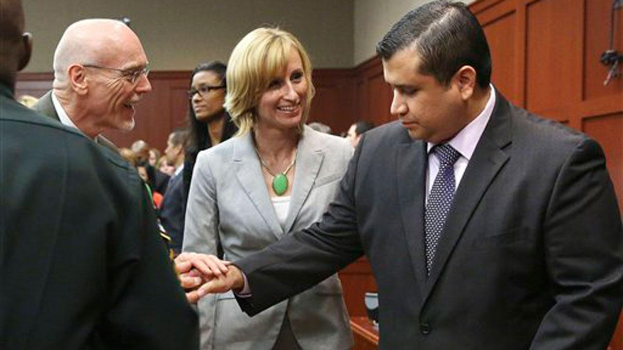 George Zimmerman, right, is congratulated by his defense team after being found not guilty during Zimmermans trial in Seminole circuit court in Sanford, Fla. on Saturday, July 13, 2013. Jurors found Zimmerman not guilty of second-degree murder in the fatal shooting of 17-year-old Martin in Sanford, Fla. The six-member, all-woman jury deliberated for more than 15 hours over two days before reaching their decision Saturday night. (AP Photo/Gary W. Green, Pool)
