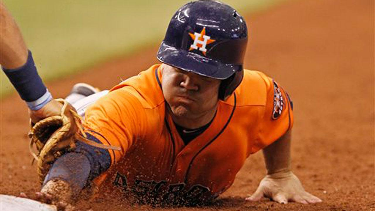 Houston Astros Jose Altuve is tagged out by Tampa Bay Rays James Loney while diving back to first base during the fifth inning of a baseball game on Saturday, July 13, 2013, in St. Petersburg, Fla. (AP Photo/Scott Iskowitz)