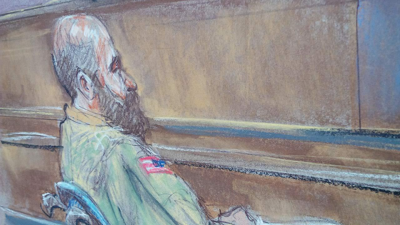 In this courtroom sketch Maj. Nidal Malik Hasan sits in court for his court-martial in Fort Hood, Texas