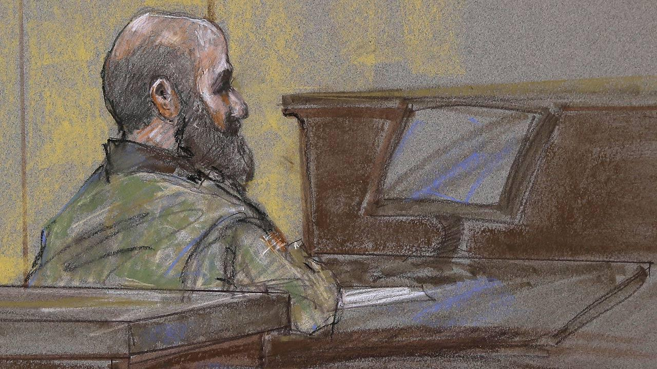 In this courtroom sketch, U.S. Army Maj. Nidal Malik Hasan is shown as the guilty verdict is read at his court martial