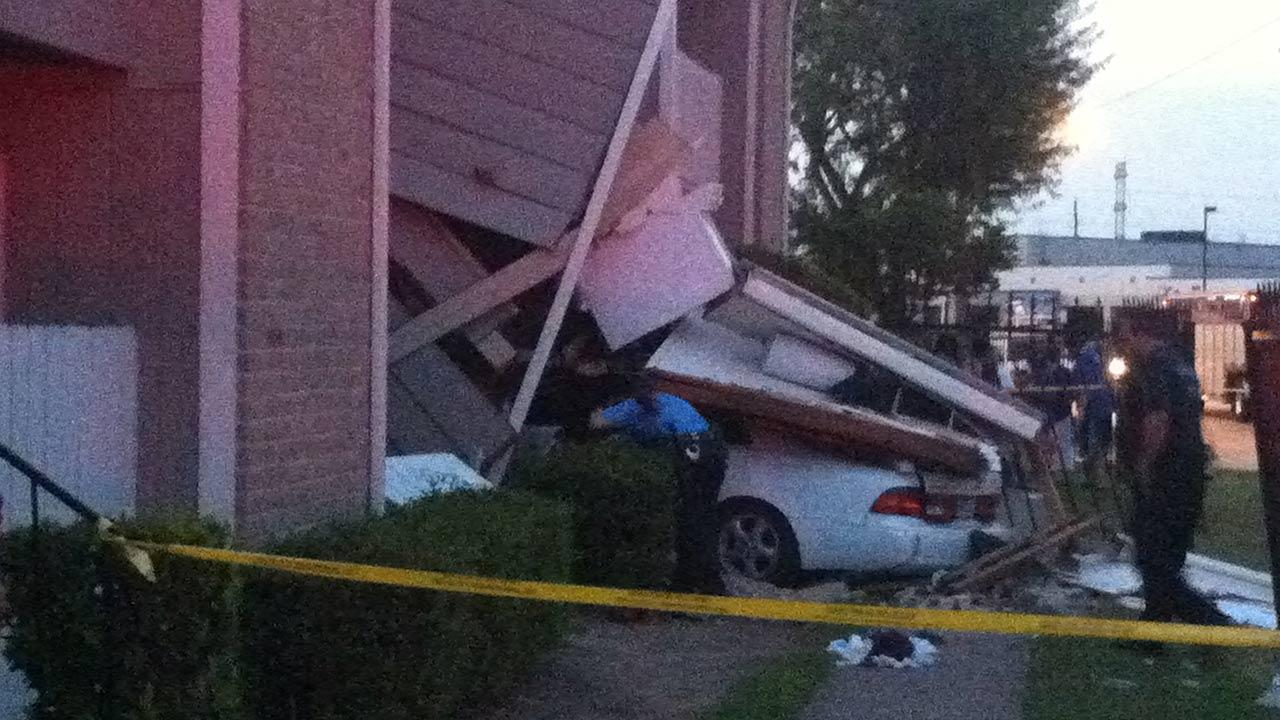 Car slams into north Houston apartment after shooting