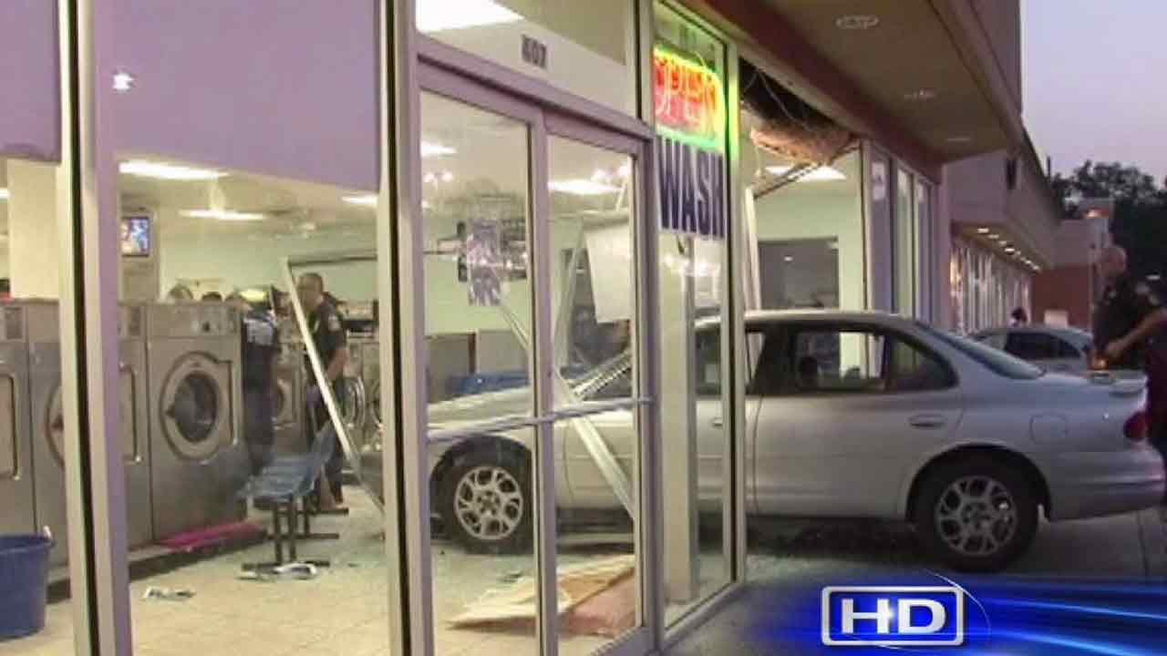 Car hits woman, crashes into north Harris County laundromat