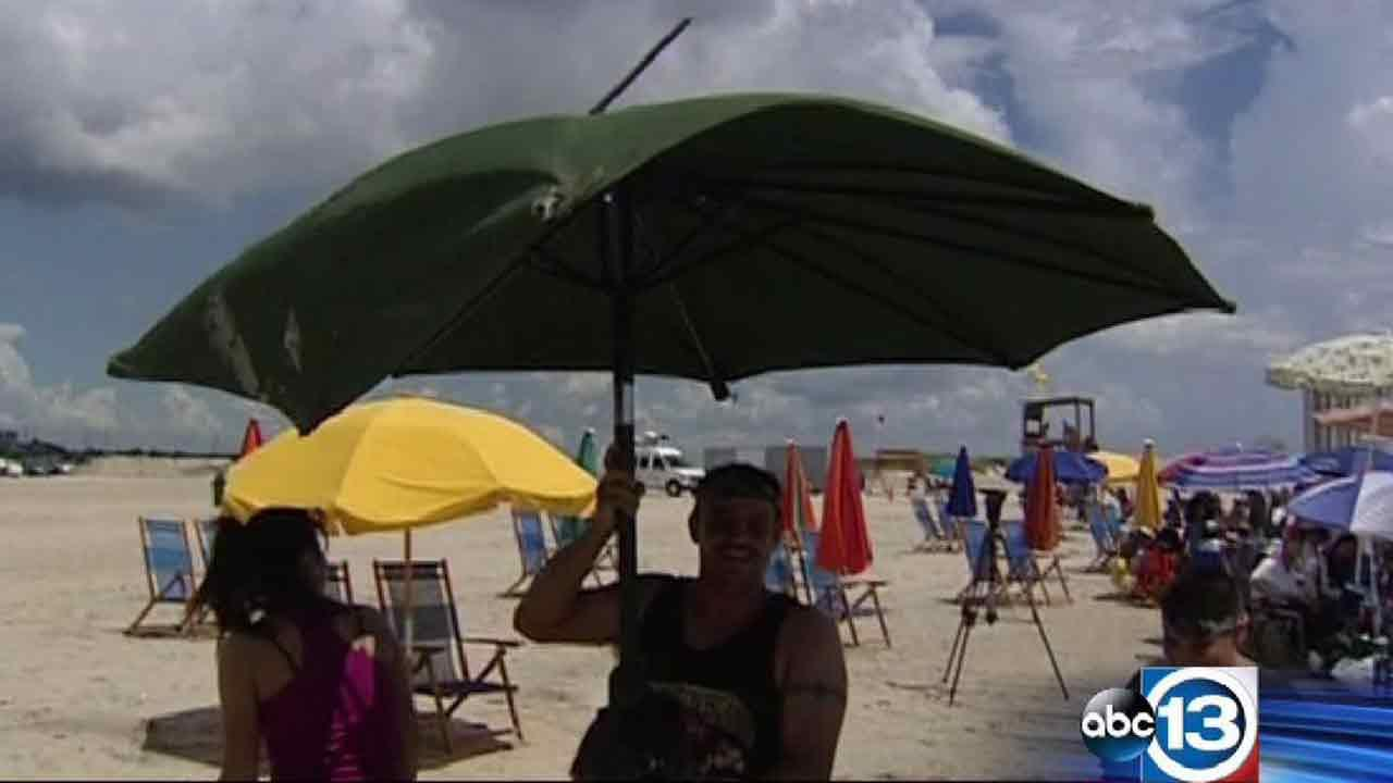 This mans umbrella was recovered after flying away in a finnel cloud on Galvestons Stewart Beach
