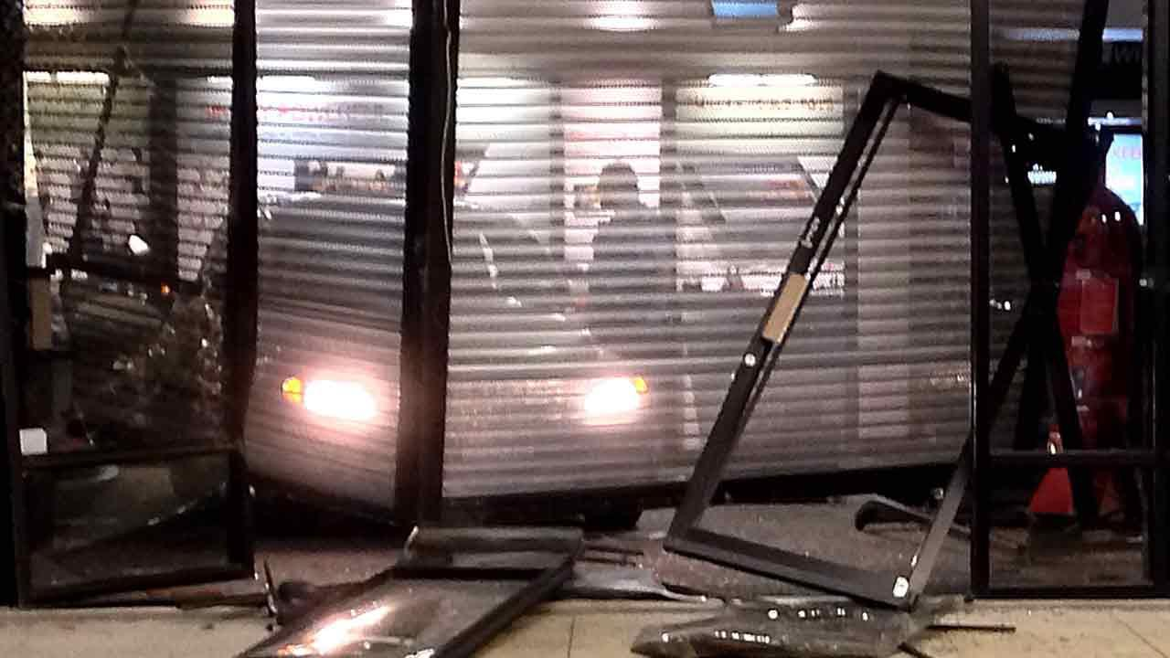 Thieves ram a car into a Verizon store to grab some cell phones but make a run for it when officers catch them right in the middle of the act.