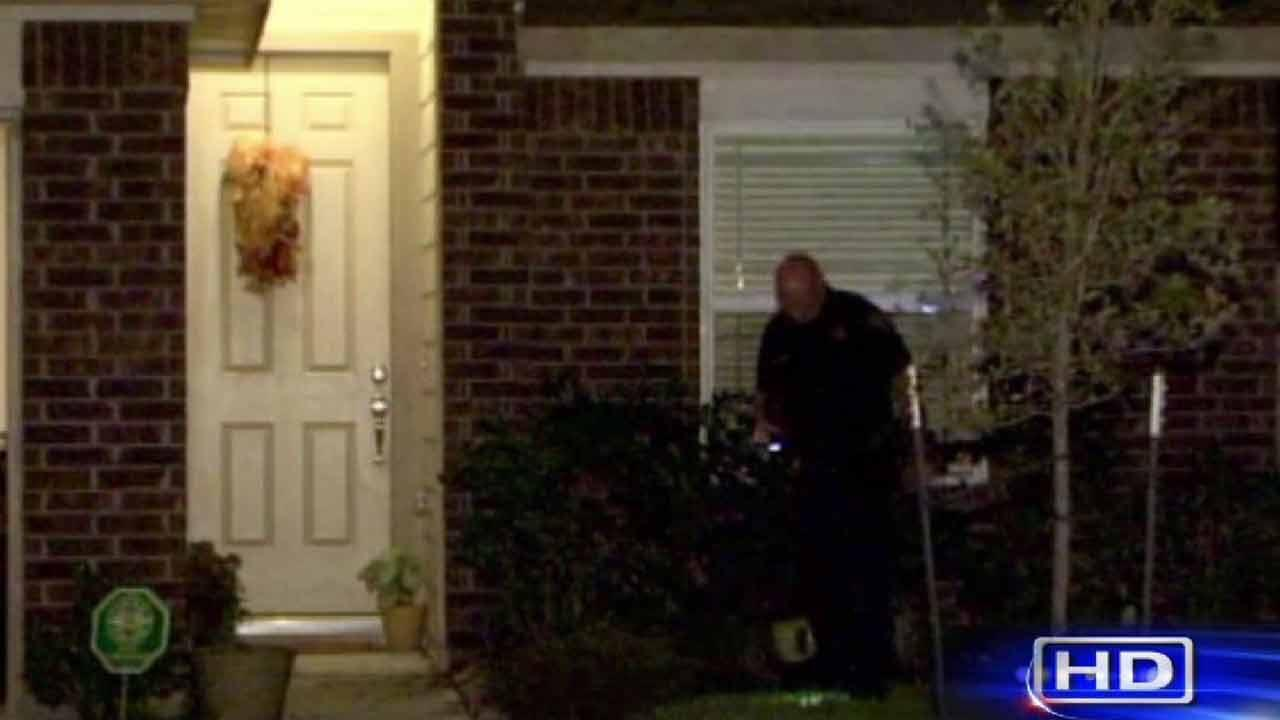 Man shot while answering front door
