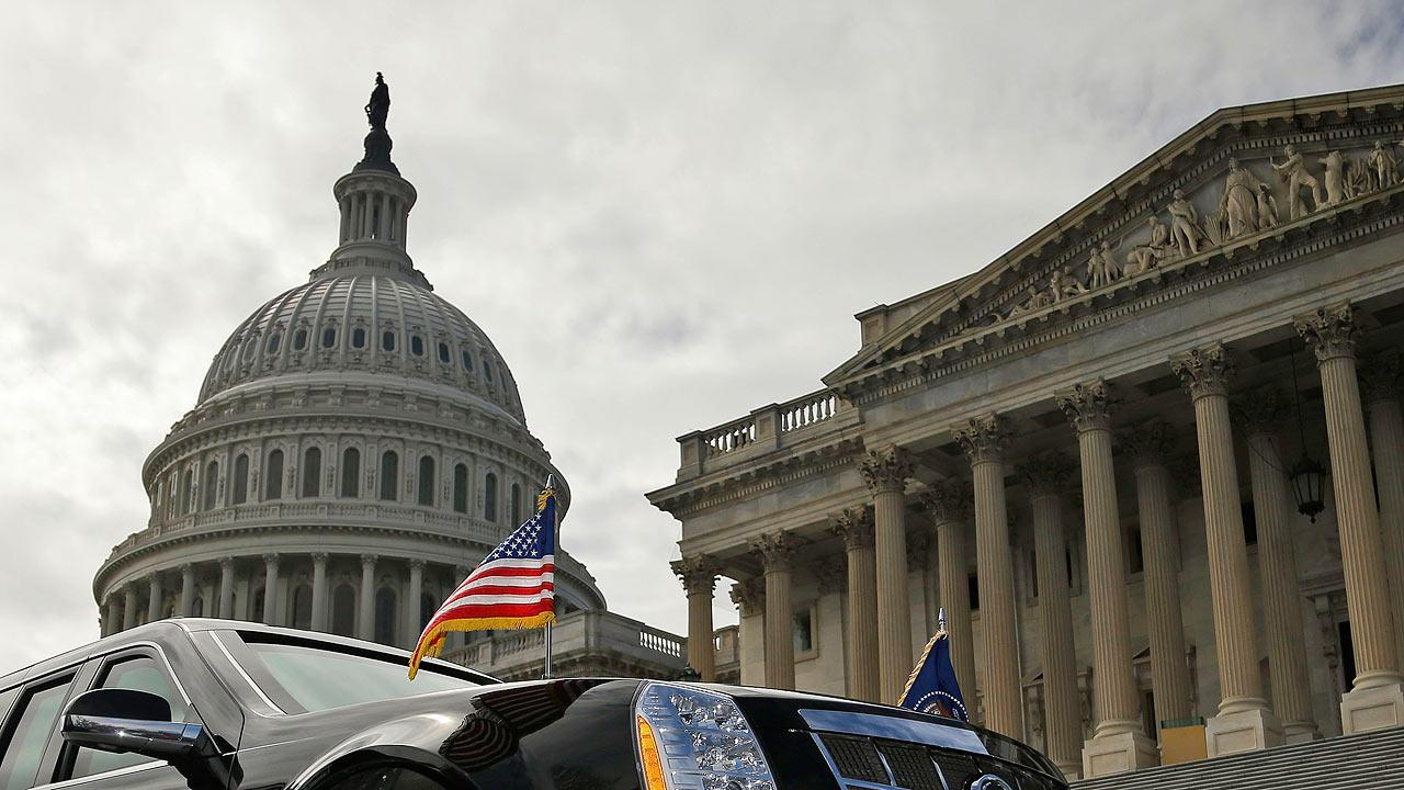 One of President Barack Obamas motorcade vehicles is seen parked in front of the US Capitol Building in Washington
