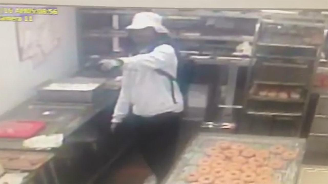 Gunman caught on camera during terrifying robbery at a donut shop