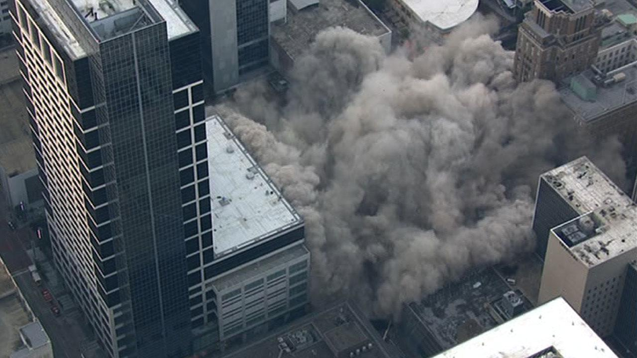 The old Foleys/Macys building in downtown Houston comes down in seconds during an implosion on Sunday, September 22, 2013