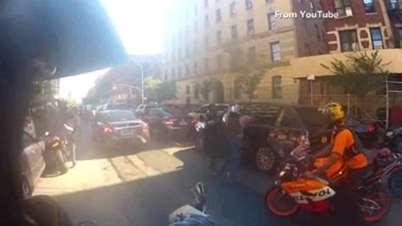 Detective arrested in NYC motorcycle-SUV melee