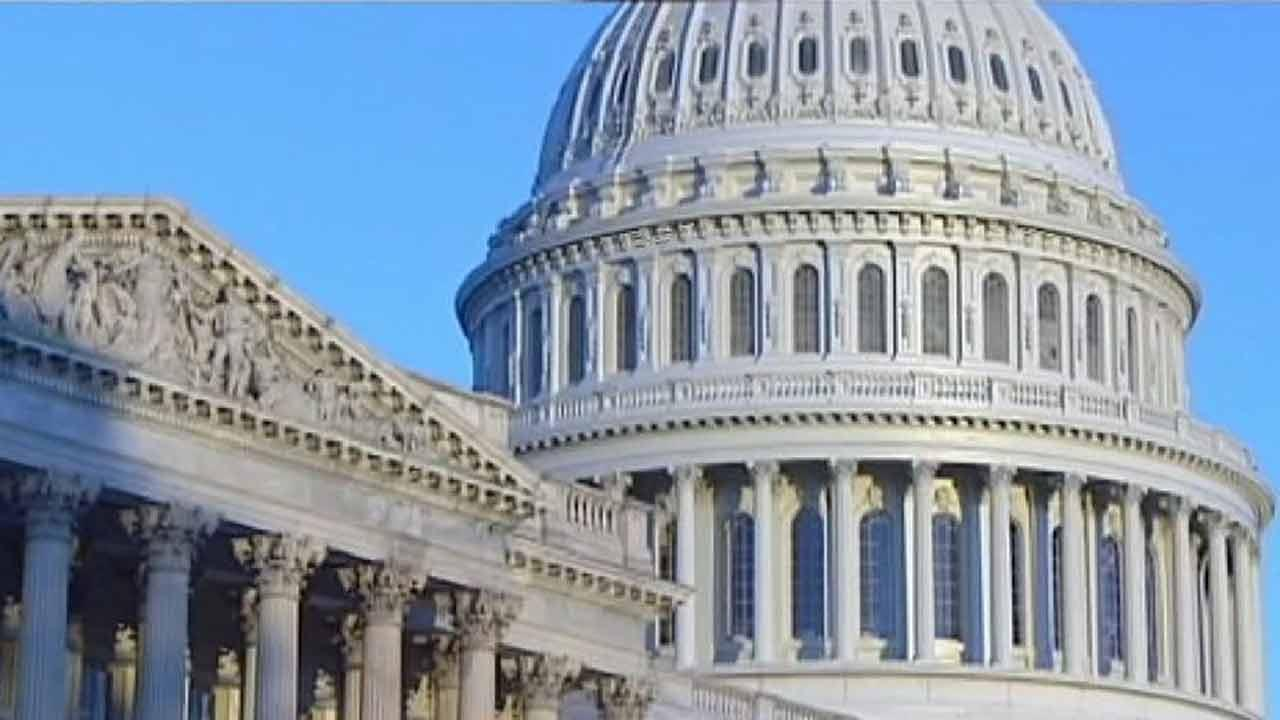 Budget, debt unresolved on shutdown's 3rd day