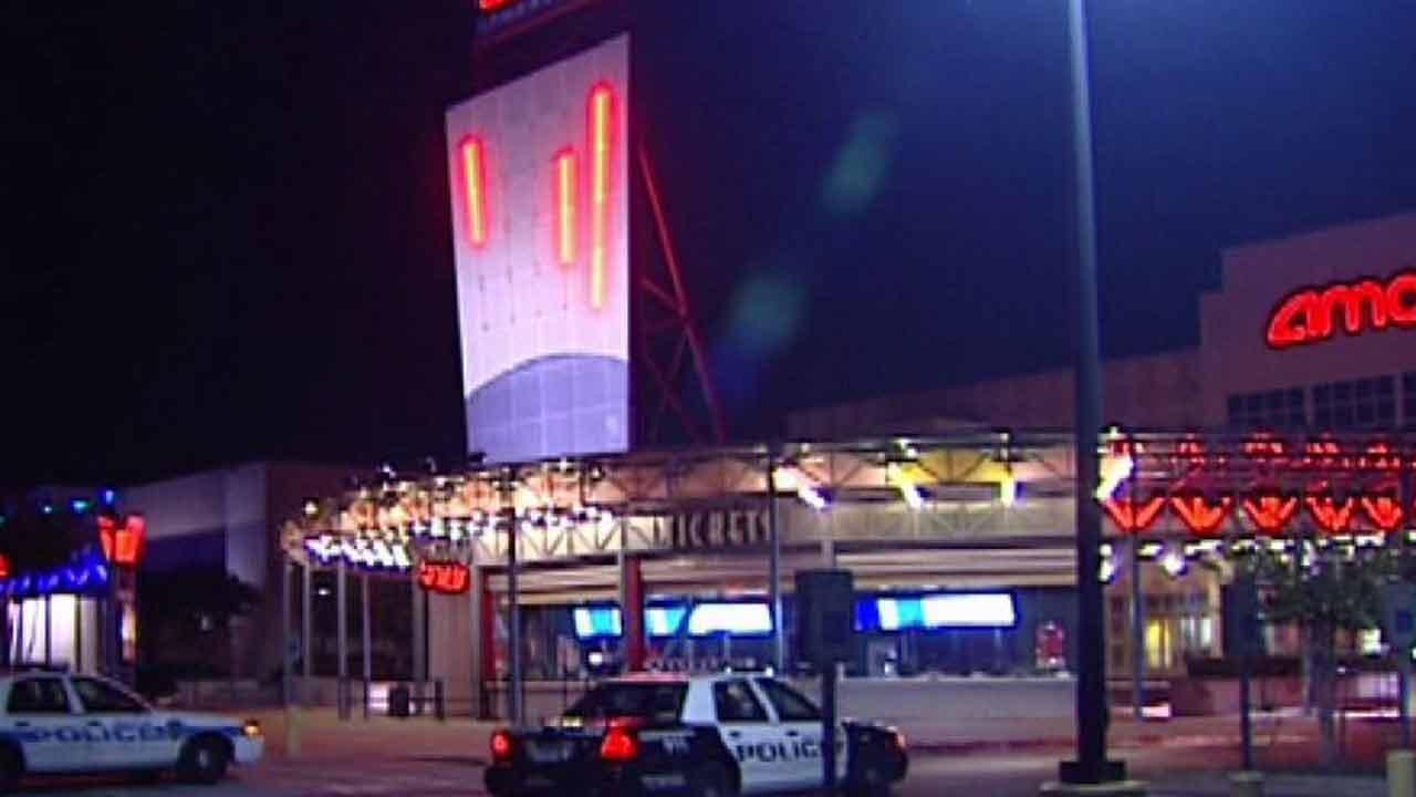 Police say the man was walking out of the theater when he was held at gunpoint and shot.