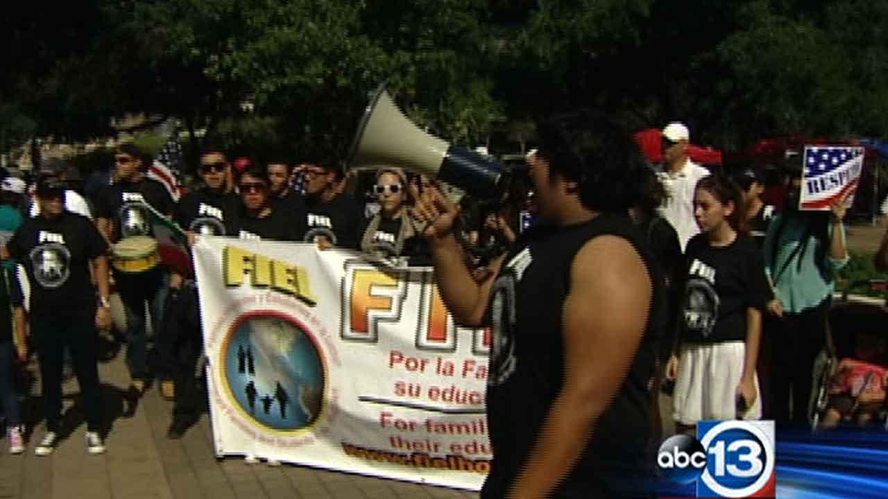 People on both sides of the immigration debate rallied outside Houston City Hall on Saturday, October 5, 2013