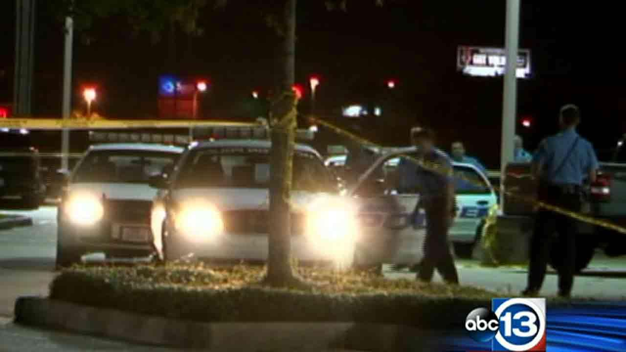 Police at the scene of a shootout outside a southeast Houston pub that injured one person