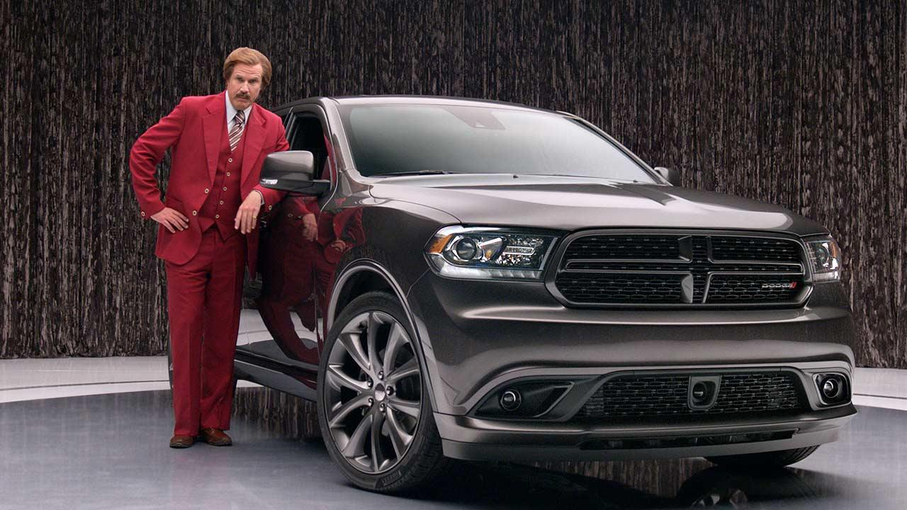 This undated photo provided by Chrysler shows Will Ferrell as Anchorman character Ron Burgundy in an advertisement for the 2014 Dodge Durango.