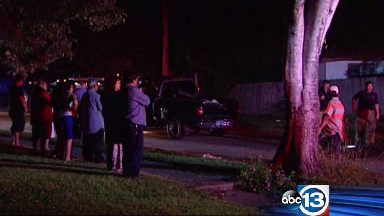 Neighbors watch as totaled cars are towed away in north Houston