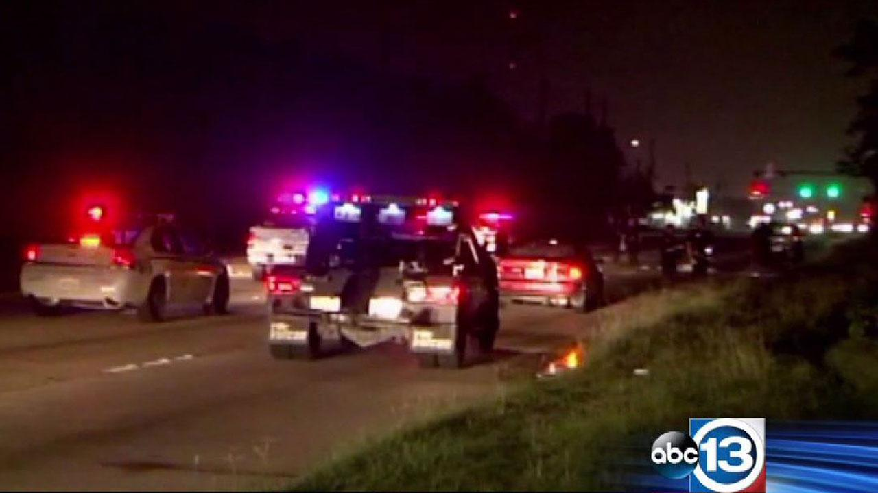 Investigators at the scene of a fatal auto-pedestrian crash in north Harris County