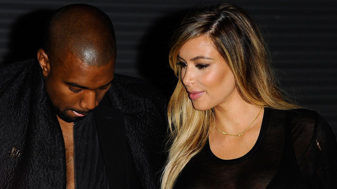 Kanye West, left, and Kim Kardashian arrive to attend Givenchys ready-to-wear Spring/Summer 2014 fashion collection in Paris