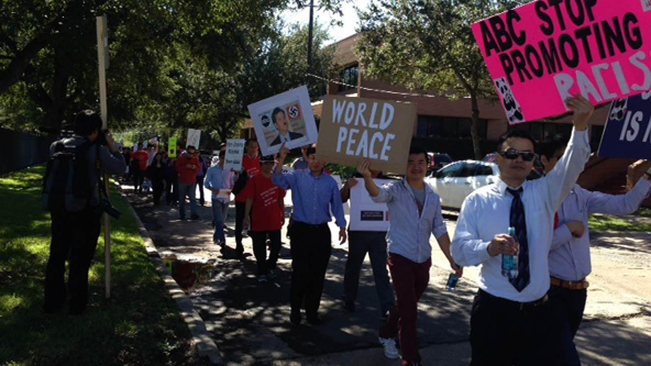 Protesters upset about a segment on Jimmy Kimmel Live march around abc13 studios in Houston