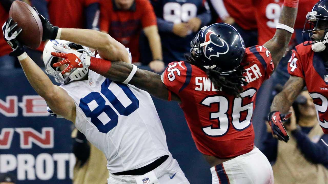 Indianapolis Colts Coby Fleener (80) catches a pass in front of Houston Texans D.J. Swearinger (36) and Johnathan Joseph (24) for a two-point conversion during the fourth quarter of an NFL football game Sunday, Nov. 3, 2013, in Houston. Indianapolis won 27-24. (AP Photo/David J. Phillip)