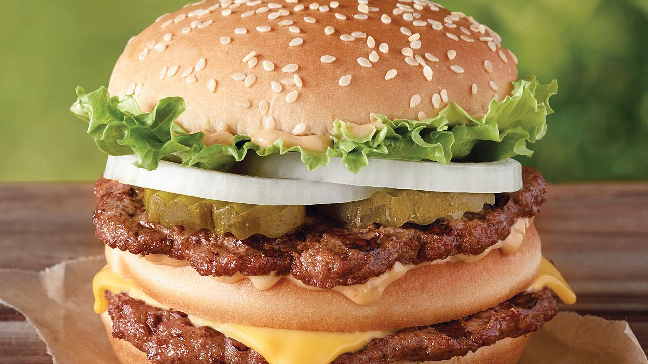 This undated image provided by Burger King shows the Big King sandwich. Burger King says its an addition to the permanent menu rolling out this week. (AP Photo/Burger King)