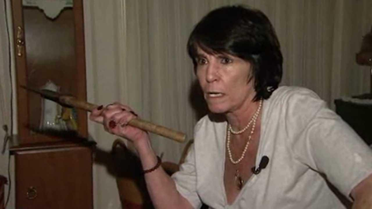 Ax-wielding woman chases thief from home