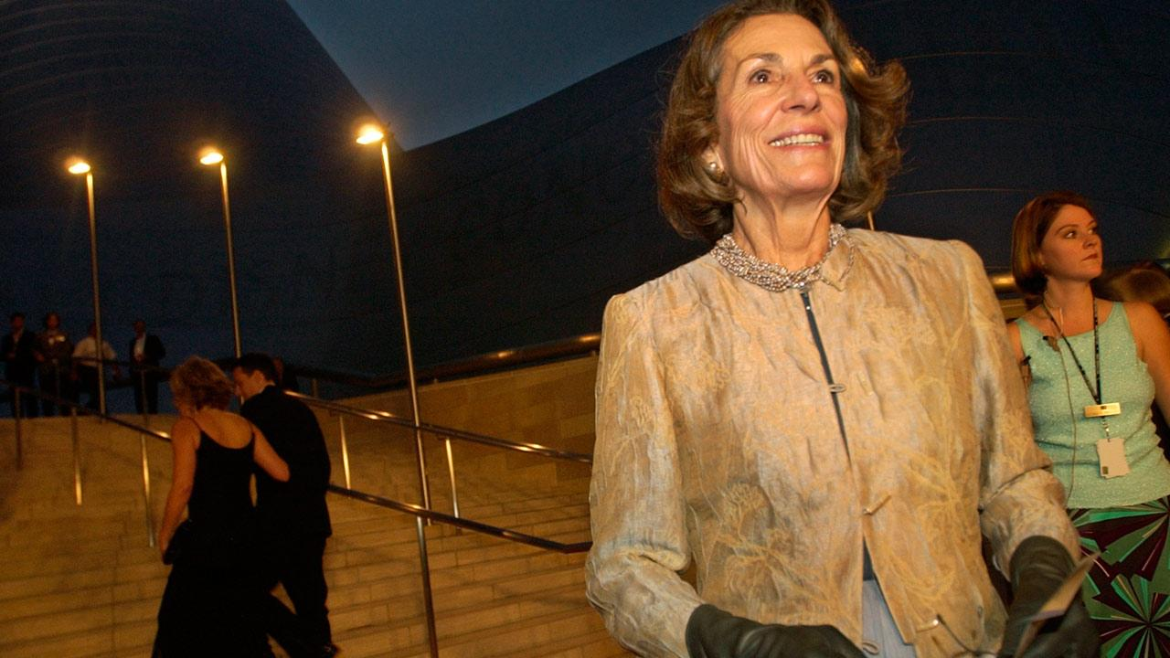 Diane Disney Miller poses for photographers as she arrives for a grand opening concert gala at the new Walt Disney Concert Hall in Los Angeles, Thursday, Oct. 23, 2003. (AP Photo/Chris Pizzello)