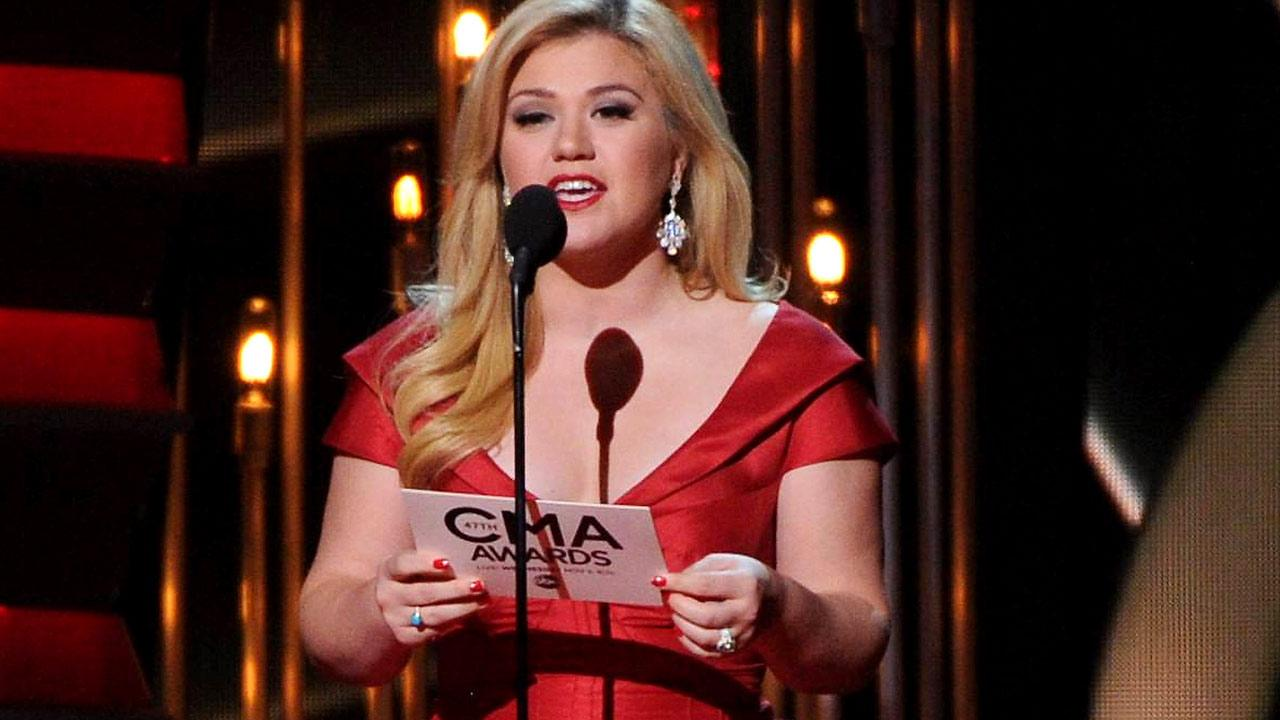 Kelly Clarkson speaks onstage at The 47th Annual CMA Awards, on Wednesday, November 6, 2013 at Bridgestone Arena in Nashville, Tenn. (Photo by Frank Micelotta/Invision/AP Images)