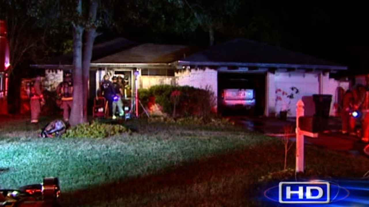 Police say a couple ran out of this north Houston home as it burned, and the womans hair was on fire