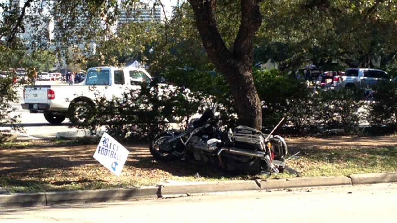 A police officer on a motorcycle was injured in an accident near Rice University