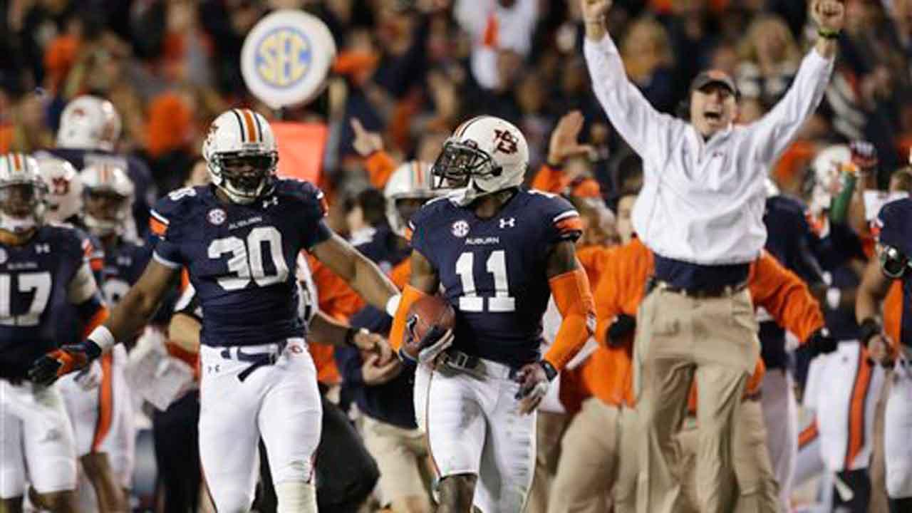 Auburn cornerback Chris Davis (11) returns a missed field-goal attempt 100-plus yards to score the game-winning touchdown as time expired in the fourth quarter of an NCAA college football game against No. 1 Alabama in Auburn, Ala., Saturday, Nov. 30, 2013