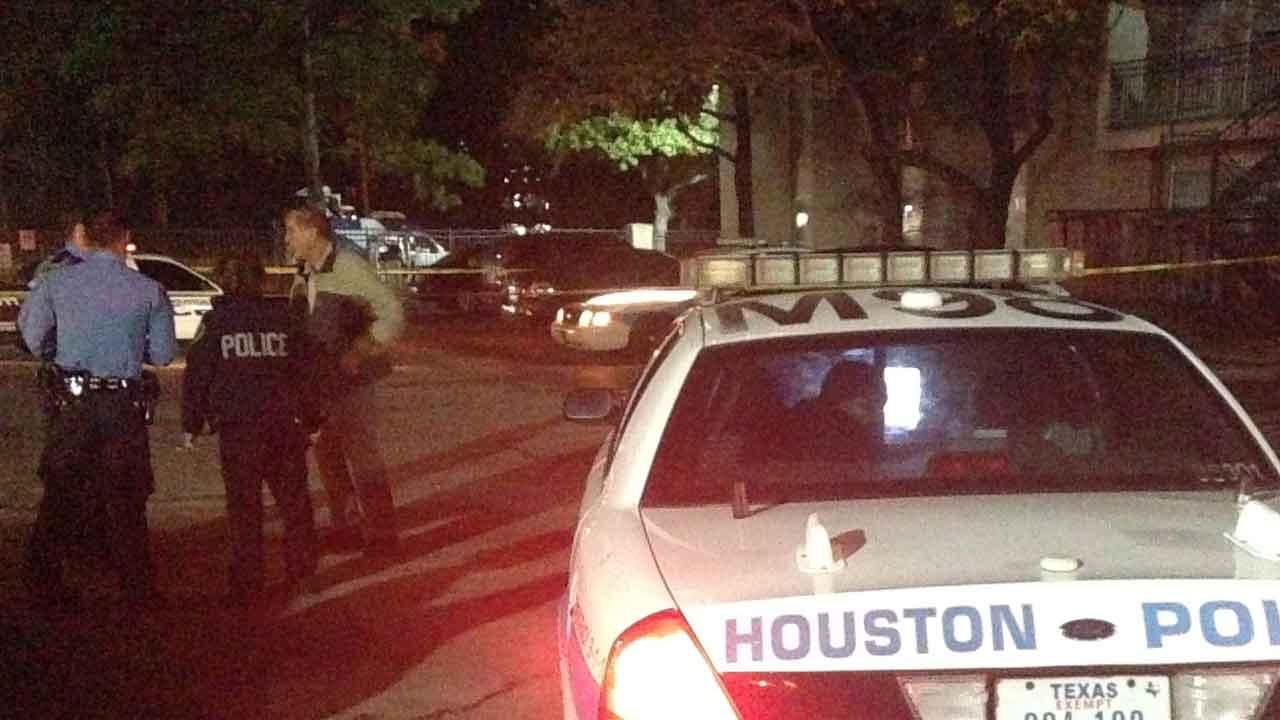 Houston police at the scene of a shooting on Greens Road in north Houston where they say a teen was shot in the face during a struggle with his brother, a security guard