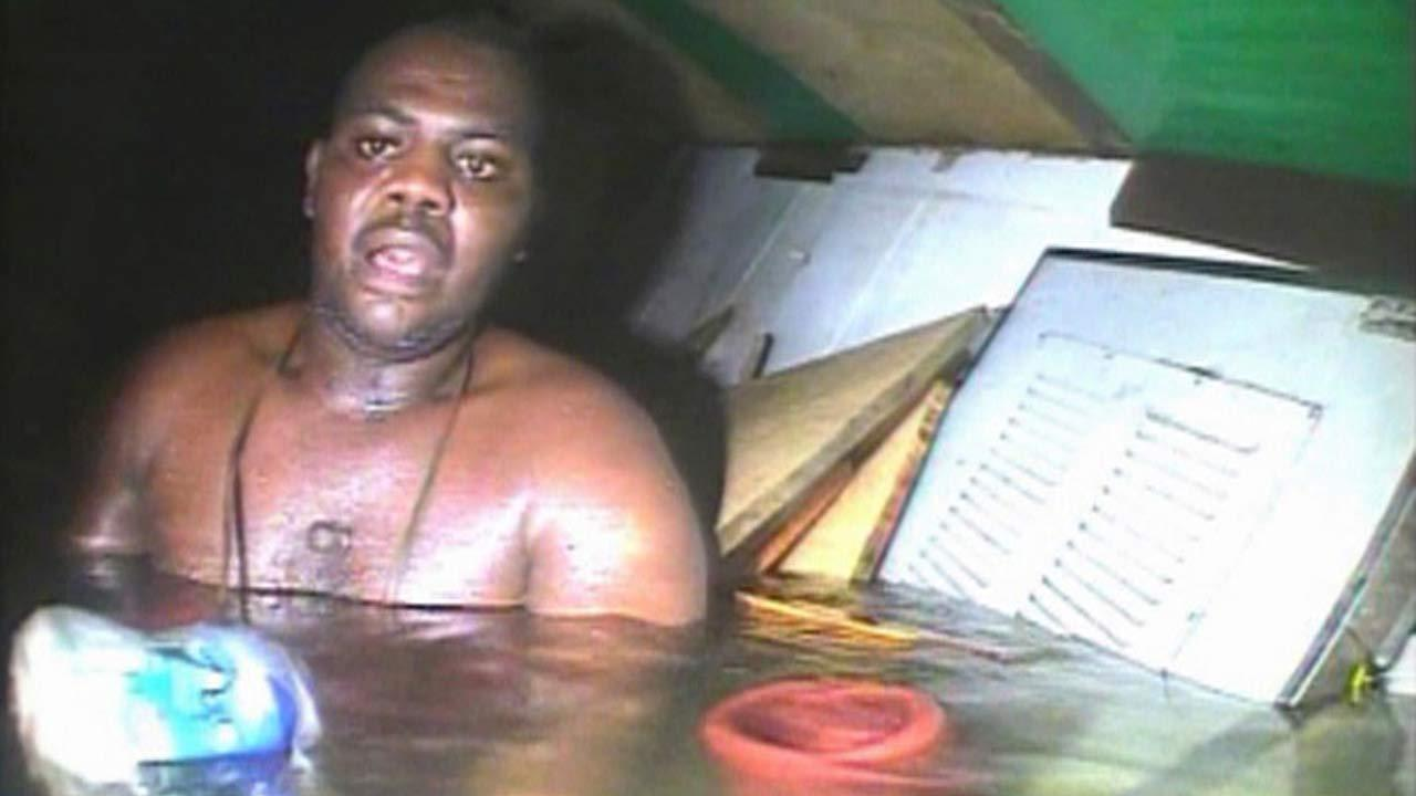 Harrison Odjegba Okene looks in awe as a rescue diver surfaces into the air pocket which has kept Okene alive for nearly three days
