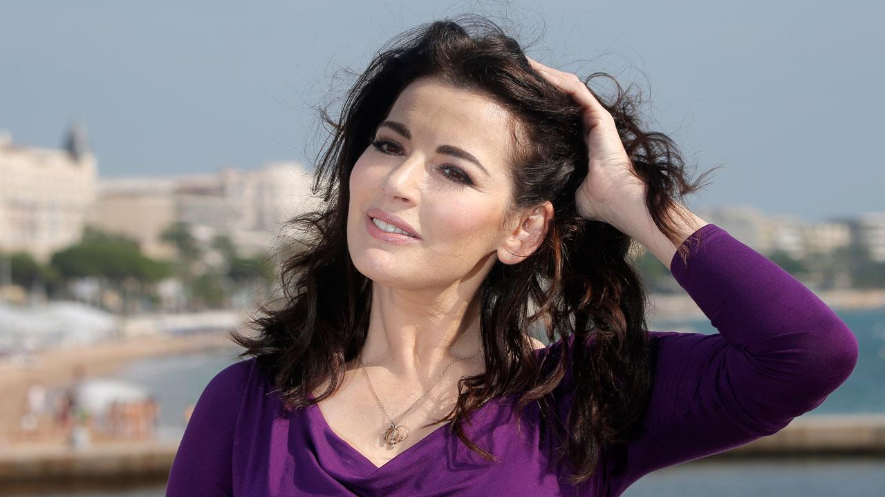 In this Tuesday, Oct. 9, 2012 file photo, English food writer, journalist and broadcaster, Nigella Lawson poses during the 28th MIPCOM (International Film and Programme Market for Tv, Video,Cable and Satellite) in Cannes, southeastern France. British police say they are investigating after a newspaper published photos of Nigella Lawsons husband Charles Saatchi with his hands around the celebrity chefs throat. The Sunday People newspaper ran pictures of what it said was the couples violent argument at a London restaurant on June 9, 2013. (AP Photo/Lionel Cironneau, File)