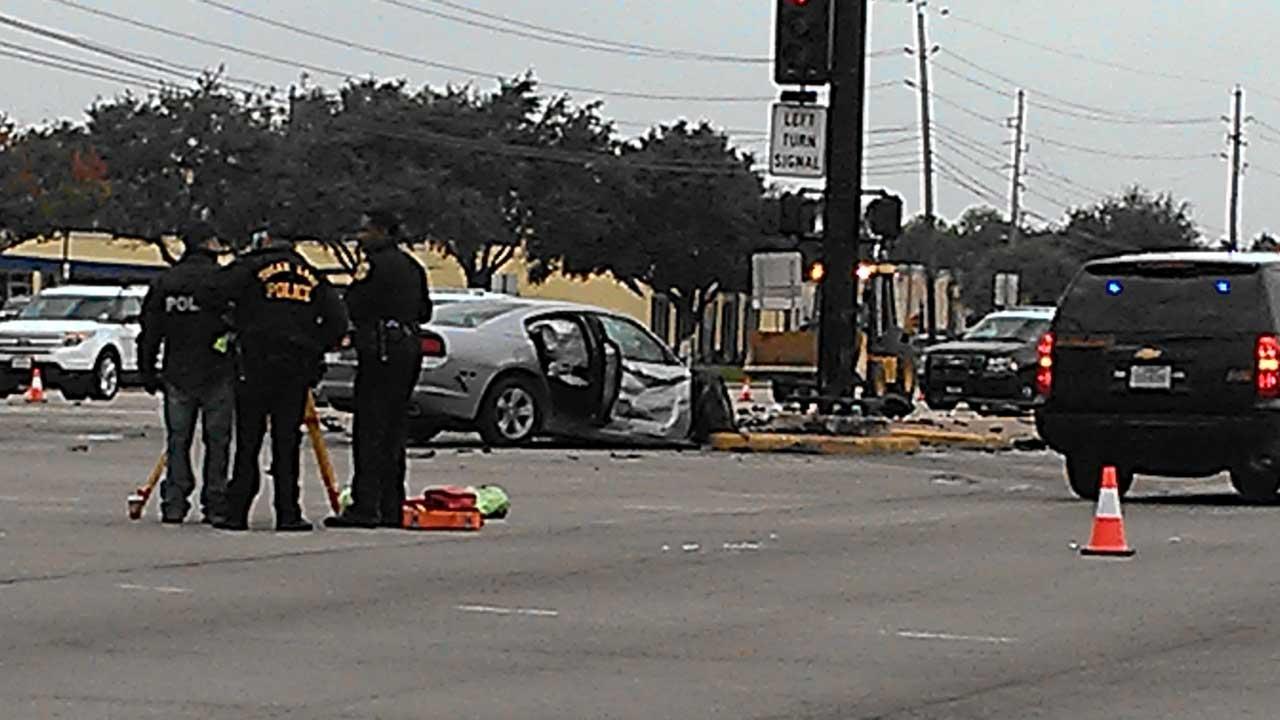 Police investigate the scene of a fatal crash in Sugar Land