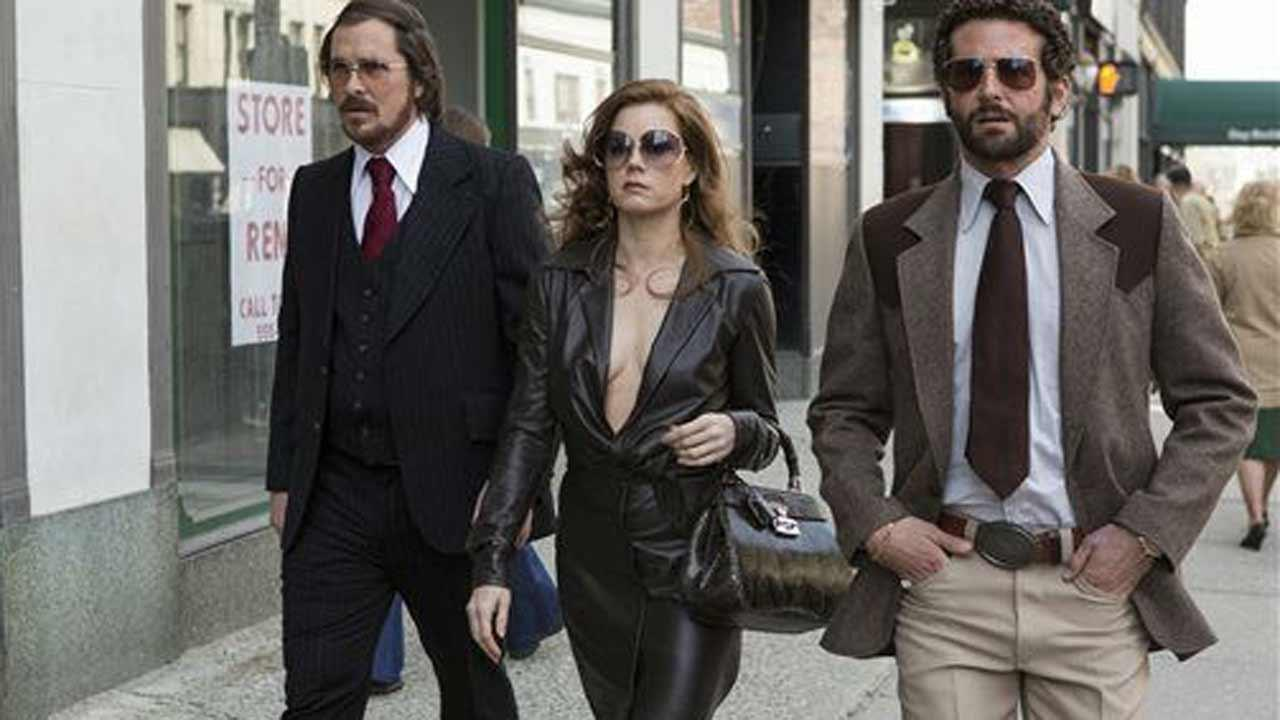 This photo released by Sony Pictures shows Christian Bale, left, as Irving Rosenfeld, Amy Adams as Sydney Prosser, and Bradley Cooper as Richie Dimaso walking down Lexington Avenue in a scene from Columbia Pictures film, American Hustle. The film was nominated for a Golden Globe for best motion picture, musical or comedy on Thursday, Dec. 12, 2013. The 71st annual Golden Globes will air on Sunday, Jan. 12. (AP Photo/Sony - Columbia Pictures, Fran?ois Duhamel) (AP Photo/ Francois Duhamel)