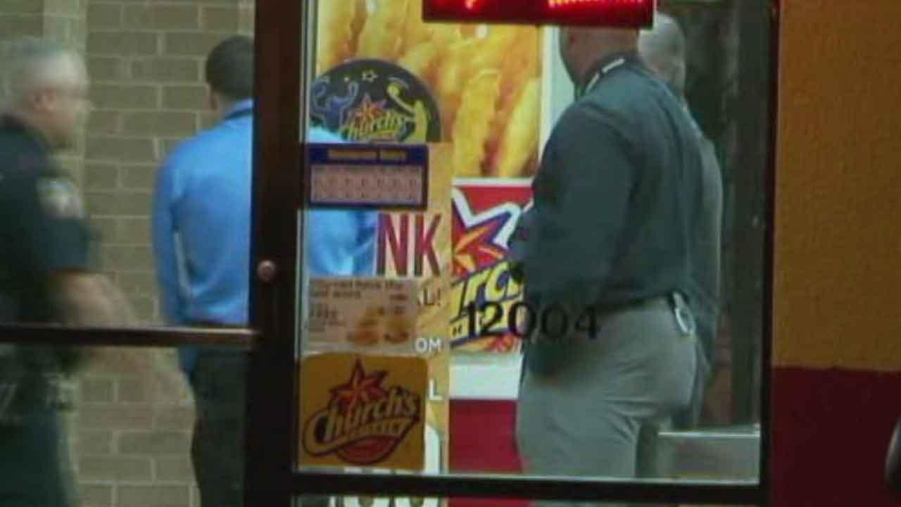 Investigators at the scene of a shooting at a Churchs Chicken in Harris County