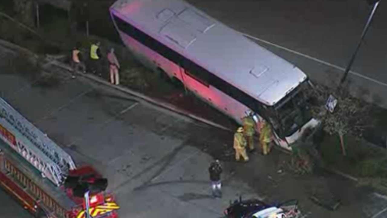 13 hurt as tour bus crashes on California freeway