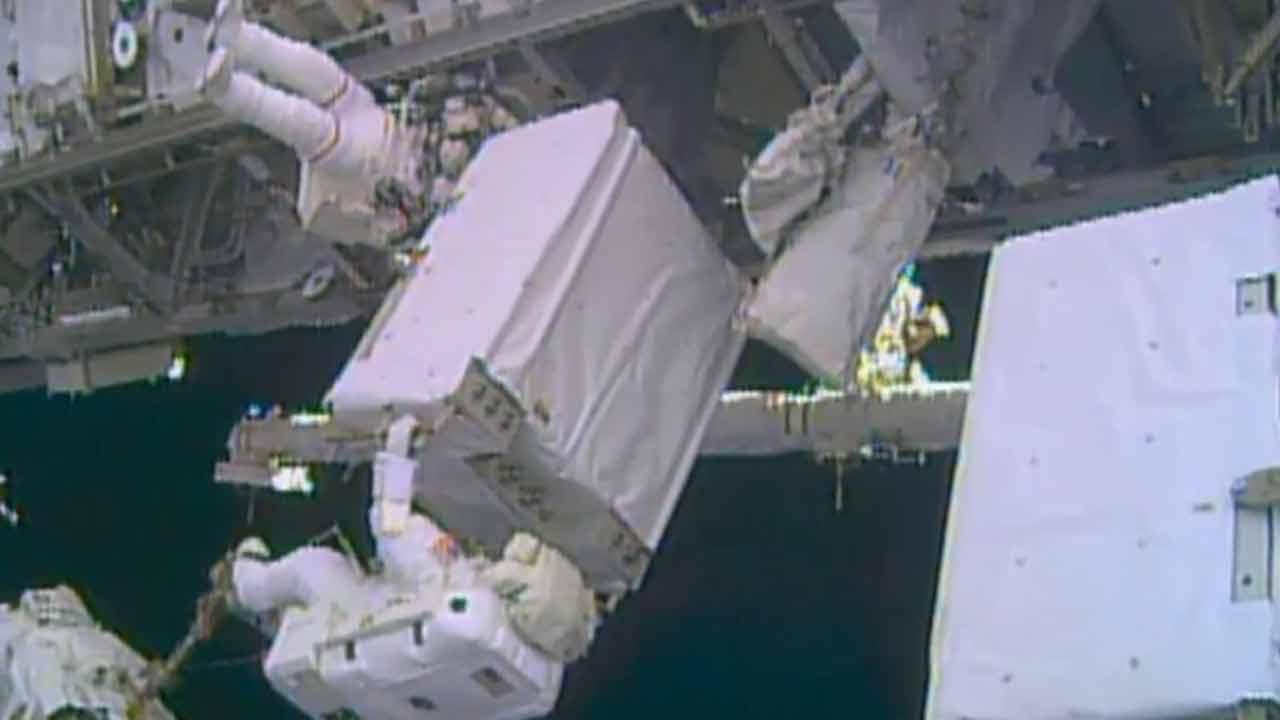 Astronauts wrap up rare Christmas Eve spacewalk to repair cooling system
