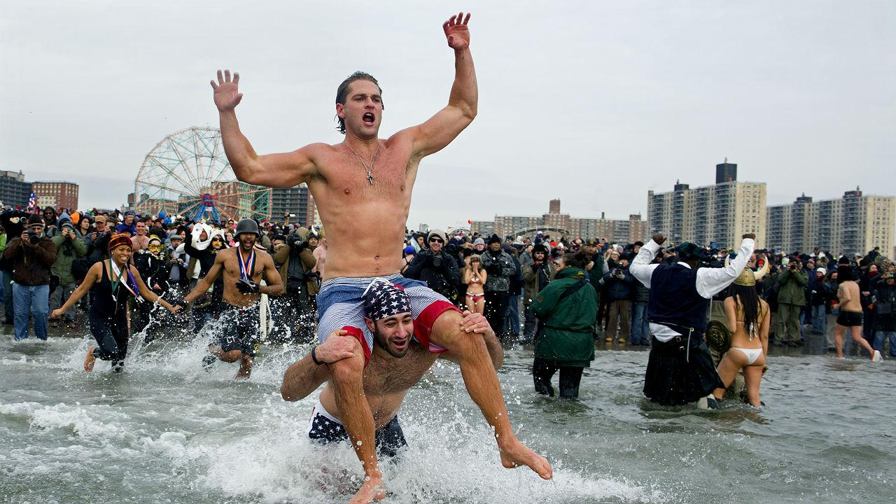 Swimmers jump into frigid waters at Coney Island beach