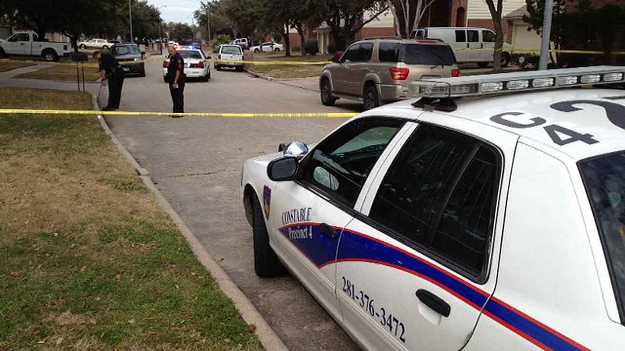Deputies at the scene of a shooting in Harris County