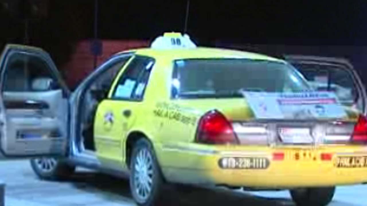 Taxi passenger shot