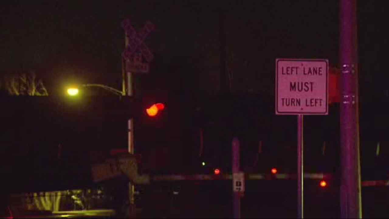 Investigators say a mans car was struck by a train, killing him instantly after he drove around the downed crossing arms