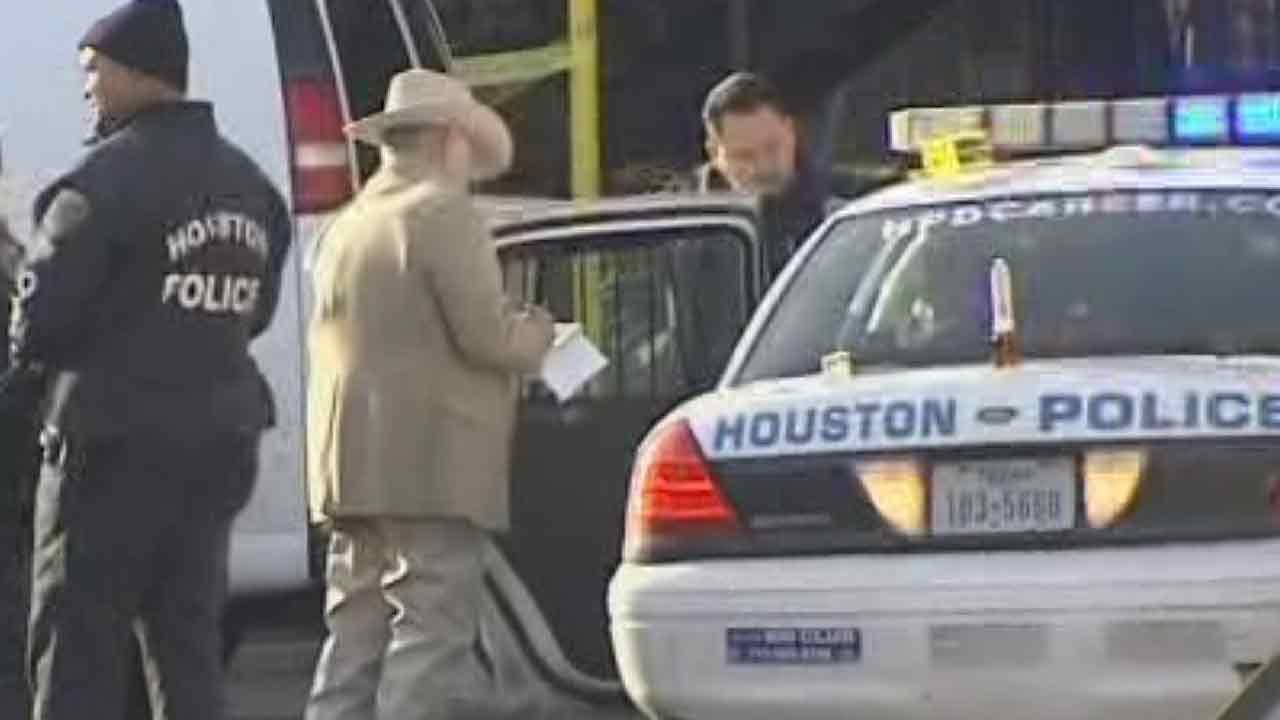 Investigators at the scene of a homicide on Lawndale in southeast Houston