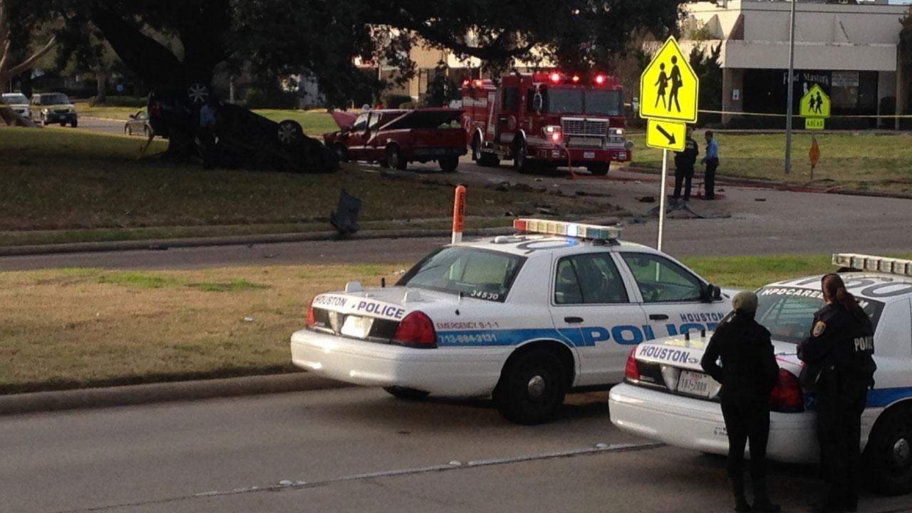 Police look on at the scene of a fatal crash in southwest Houston