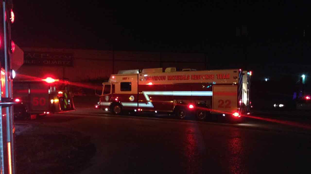 Firefighters at a hazmat scene after a crash in northwest Houston