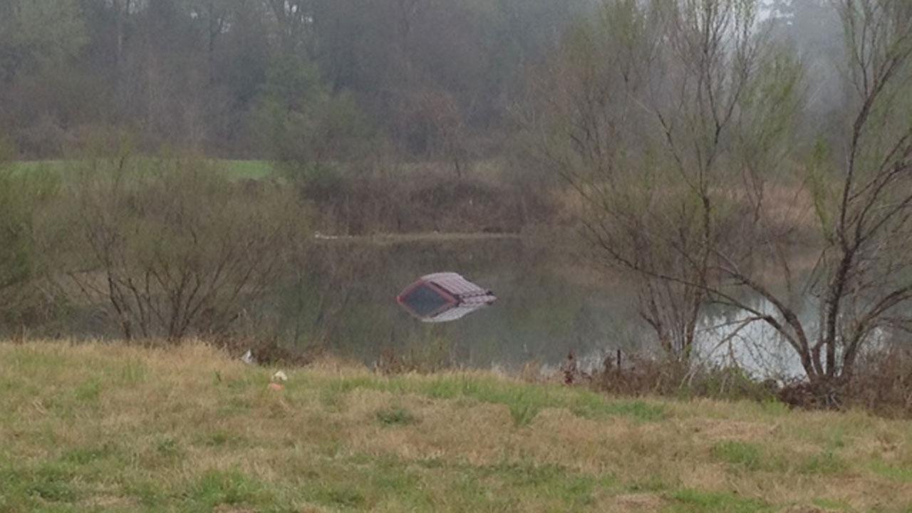 Car in water in Humble