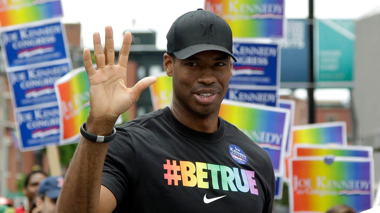 NBA veteran Jason Collins, left, the first active player in one of four major U.S. professional sports leagues to come out as gay, marches in Bostons gay pride parade alongside U.S. Rep. Joe Kennedy III, a college roommate, Saturday, June 8, 2013, in Boston.