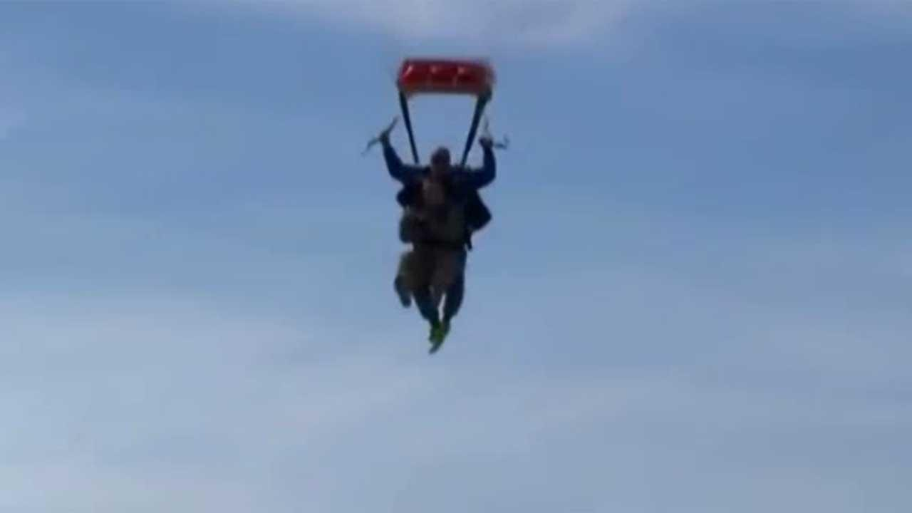 Soldier falls from the sky to surprise sons