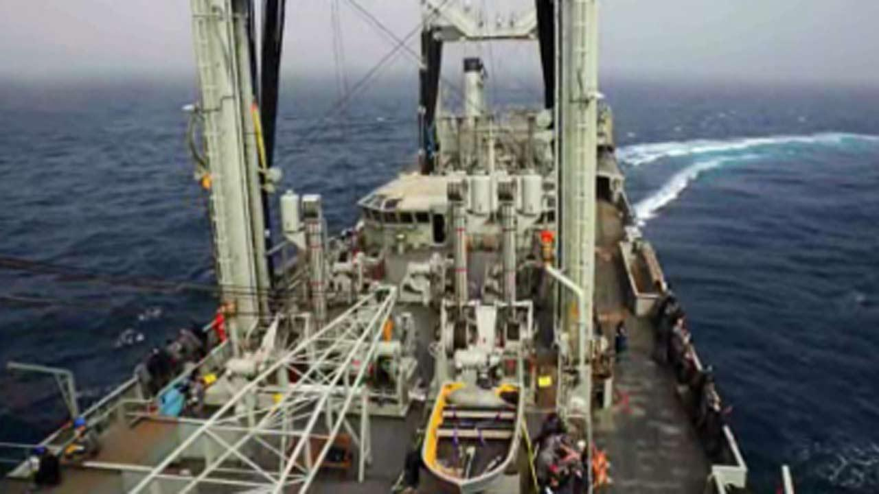 Crew onboard HMAS Success line the decks after a potential sighting was reported in the search for MH370 .
