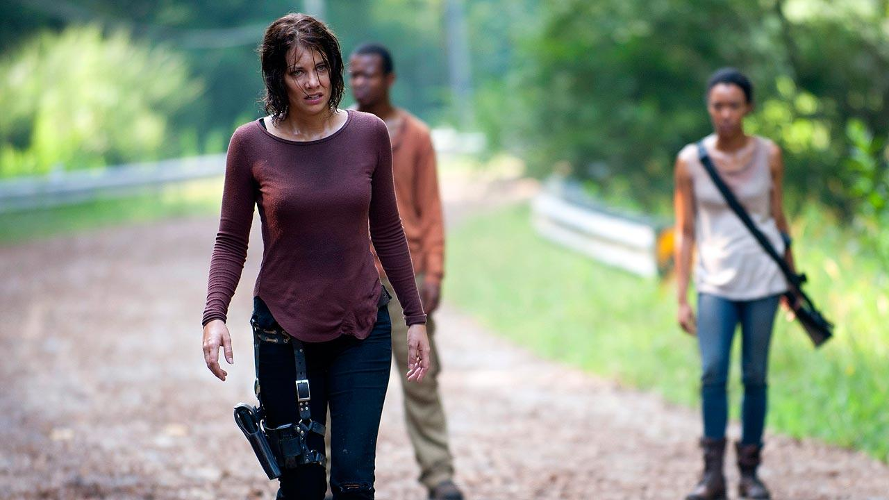 This undated image released by AMC shows Lauren Cohan as Maggie Greene, left, in a scene from The Walking Dead.